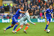 (Caption correction) Eden Hazard (10) of Chelsea battles for possession with Lee Peltier (2) of Cardiff City during the Premier League match between Cardiff City and Chelsea at the Cardiff City Stadium, Cardiff, Wales on 31 March 2019.