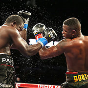"Yuniel Dorticos (right) beats Edison Miranda during the ""Judgement Day"" boxing event at American Airlines Arena on Thursday, July 10, 2014 in Miami, Florida.  (AP Photo/Alex Menendez)"