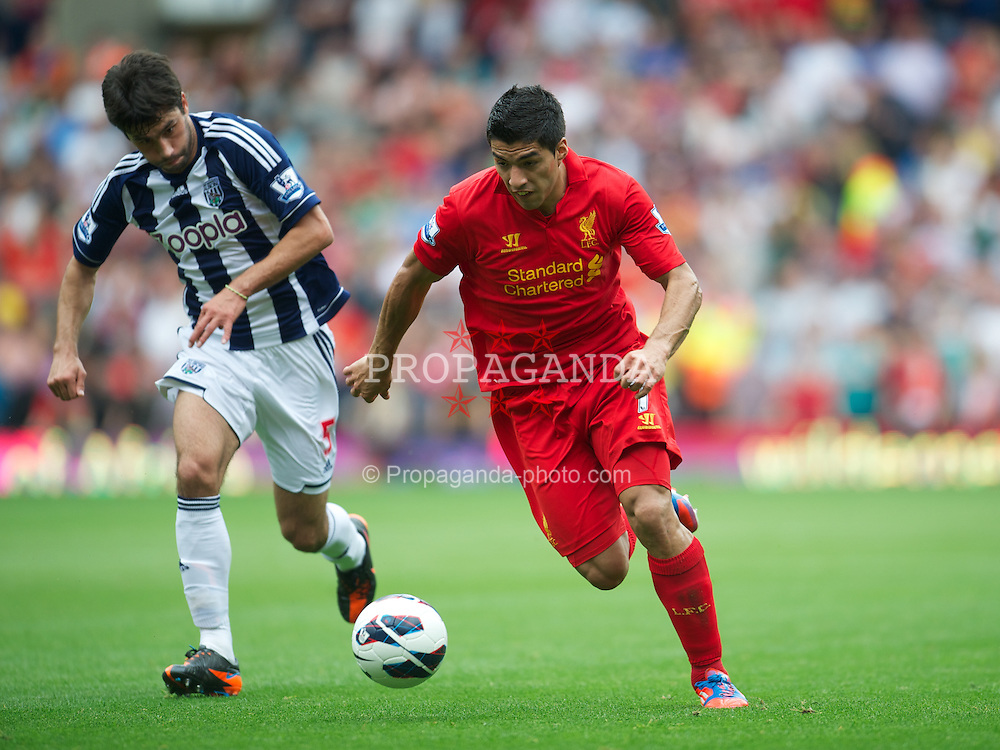 WEST BROMWICH, ENGLAND - Saturday, August 18, 2012: Liverpool's Luis Alberto Suarez Diaz in action against West Bromwich Albion's Claudio Yacob during the opening Premiership match of the season at the Hawthorns. (Pic by David Rawcliffe/Propaganda)
