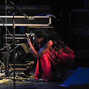 Buika having fun photographing percussionist Dany Noe during shoe