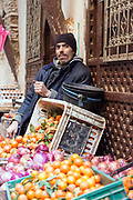 Fez, Morocco - 3rd FEBRUARY 2018 - Fruit and veg vendor poses for his photograph to be taken at his market stall in the old Fez Medina, Middle Atlas Mountains, Morocco.