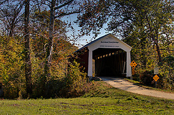08 May 2006:   Parke County Indiana is the site of the Indiana Covered Bridge Festival every October.  This is the Bowsher Ford Bridge.  It was built over Mill Creek on Bowsher Road in 1915 by Eugene Britton. This bridge has a 72' span.<br /> <br /> This image was produced in part utilizing High Dynamic Range (HDR) processes.  It should not be used editorially without being listed as an illustration or with a disclaimer.  It may or may not be an accurate representation of the scene as originally photographed and the finished image is the creation of the photographer.