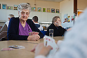 An elderly day care centre located in a secondary school in a remote former mining village, promoting intergenerational activities and community cohesion. Local elderly residents attend a lunch club with a nail bar and computer use teaching. The Dukeries College, Ollerton, Nottingham.