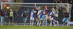 Blackburn, England - Saturday, March 3, 2007: Referee Howard Webb awards a goal as West Ham United's Bobby Zamora celebrate scoring the second goal after the ball is controversially cleared off the Blackburn Rovers' goal line, during the Premiership match against Blackburn Rovers, at Ewood Park. (Pic by David Rawcliffe/Propaganda)