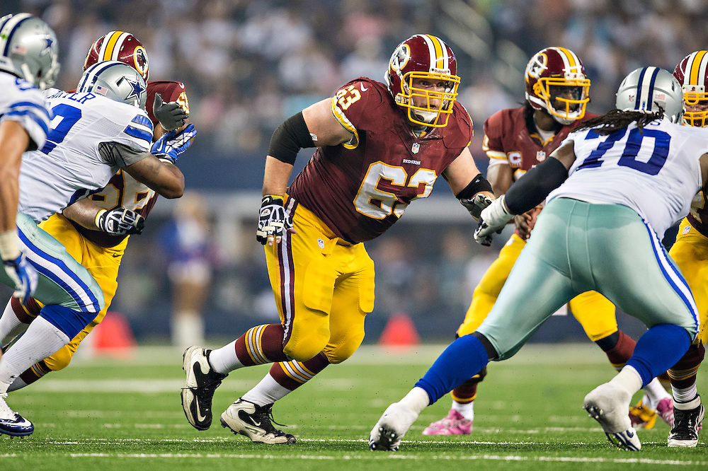 ARLINGTON, TX - OCTOBER 13:  Will Montgomery #63 of the Washington Redskins blocks against the Dallas Cowboys at AT&T Stadium on October 13, 2013 in Arlington, Texas.  The Cowboys defeated the Redskins 31-16.  (Photo by Wesley Hitt/Getty Images) *** Local Caption *** Will Montgomery