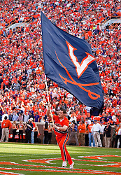 November 21, 2009; Clemson, SC, USA;  Virginia Cavaliers cheerleader carries a large flag in the end zone after a touchdown against the Clemson Tigers during the first quarter at Memorial Stadium.  Clemson defeated Virginia 34-21.