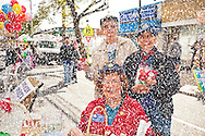 BLIZZARD SNOW DIGITALLY ADDED, to portray what fair would have looked like if it had been held the next Saturday, when it snowed.Three women Auxiliary members of American Legion post with artificial red poppies to give to people who make donations, at Merrick Street Fair in Merrick, New York, USA, on October 22, 2011.
