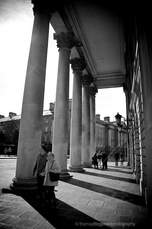 People walking among the pillars on a Dublin City Street
