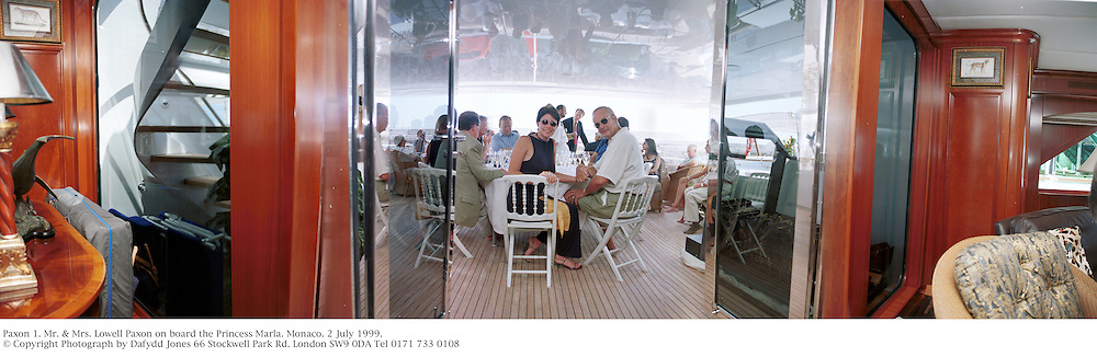Mr. &amp; Mrs. Lowell Paxon.  Champagne tasting on the Paxon yacht. Monaco. 2 July 1999.<br /> &copy; Copyright Photograph by Dafydd Jones<br /> 66 Stockwell Park Rd. London SW9 0DA<br /> Tel 0171 733 0108