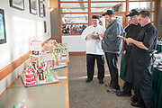 Chefs from Culinary Services judge entries for the annual gingerbread house decoration competition. Photo by Ben Siegel