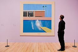 "© Licensed to London News Pictures. 06/02/2017. London, UK. A staff member views ""A Bigger Splash"" at the preview of the world's most extensive retrospective of the work of David Hockney at the Tate Britain, which will be on display 9 February to 29 May 2017. Photo credit : Stephen Chung/LNP"