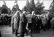 The funeral of Brendan Behan arrives at Glasnevin Cemetery. The hard-living playwright, novelist and poet was only forty-one when he died..23.03.1964