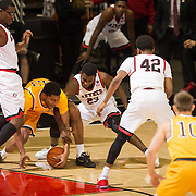 31 January 2017:  The San Diego State Aztecs men's basketball team hosts Wyoming Tuesday night at Viejas Arena. San Diego State guard Montaque Gill-Caesar (23) attempts to steal the ball from Wyoming forward Jordan Naughton (33) in the first half. The Aztecs lead the Cowboys 31-27 at half time. www.sdsuaztecphotos.com