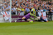 Lewis Price saves from Vadaine Oliver during the Friendly match between York City and Sheffield Wednesday at Bootham Crescent, York, England on 18 July 2015. Photo by Simon Davies.