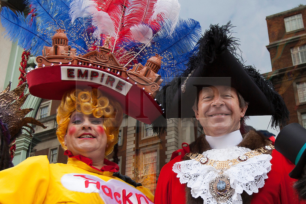 © licensed to London News Pictures. London, UK 13/11/2012. The new Mayor of London (right) and cast members of Dick Whittington and his Cat at the Hackney Empire launching a new window of Fortnum & Mason in Piccadilly, London. Photo credit: Tolga Akmen/LNP