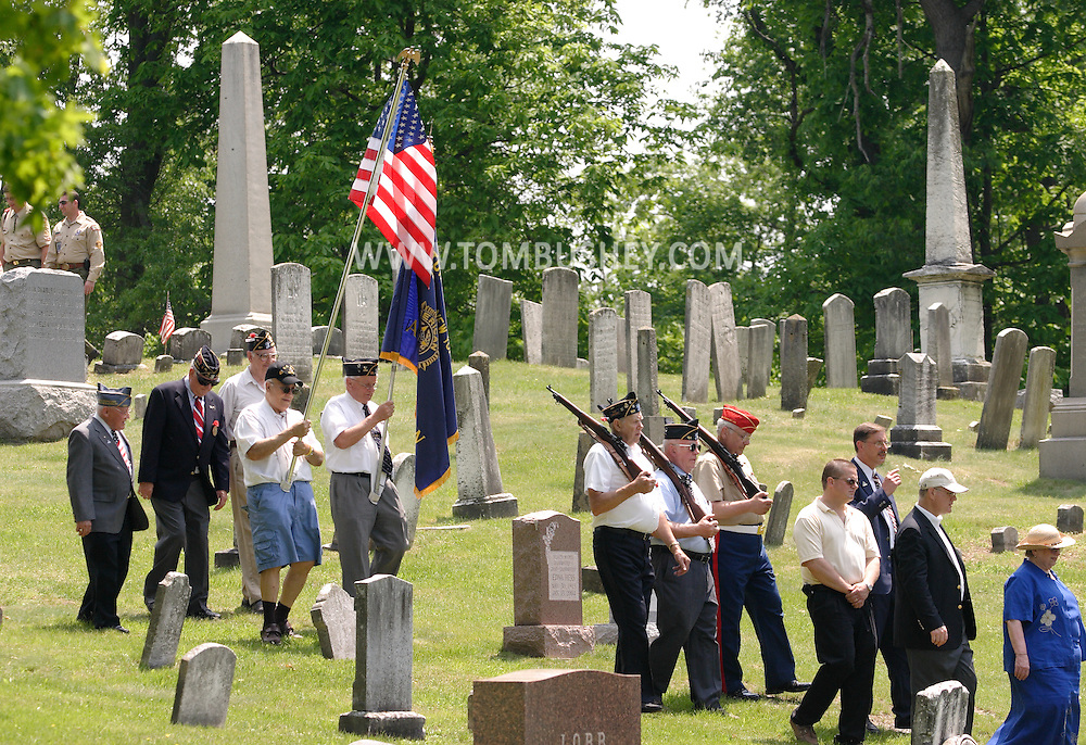Hamptonburgh, N.Y. - Veterans and other participants march through Hamptonburgh Cemetery during a Memorial Day service on May 29, 2006. ©Tom Bushey/