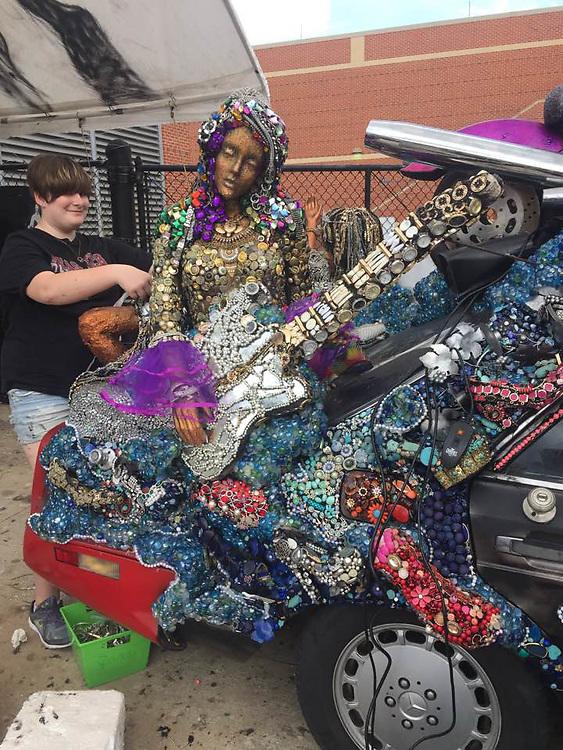 "Heights High School art car ""Purple Reign"" also includes Sheila E on guitar."