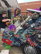 "Heights High School art car ""Purple Reign"" also includes Sheila E on guitar."