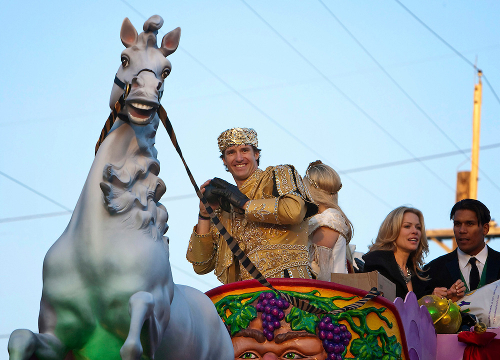 Super Bowl MVP and New Orleans Saints Quarterback Drew Brees #9 as King of Bacchus throw footballs to the fans in the Krewe of Bacchus parade as they get ready to roll at Tchoupitoulas Street and Napoleon Avenue in New Orleans, Louisiana. USA.