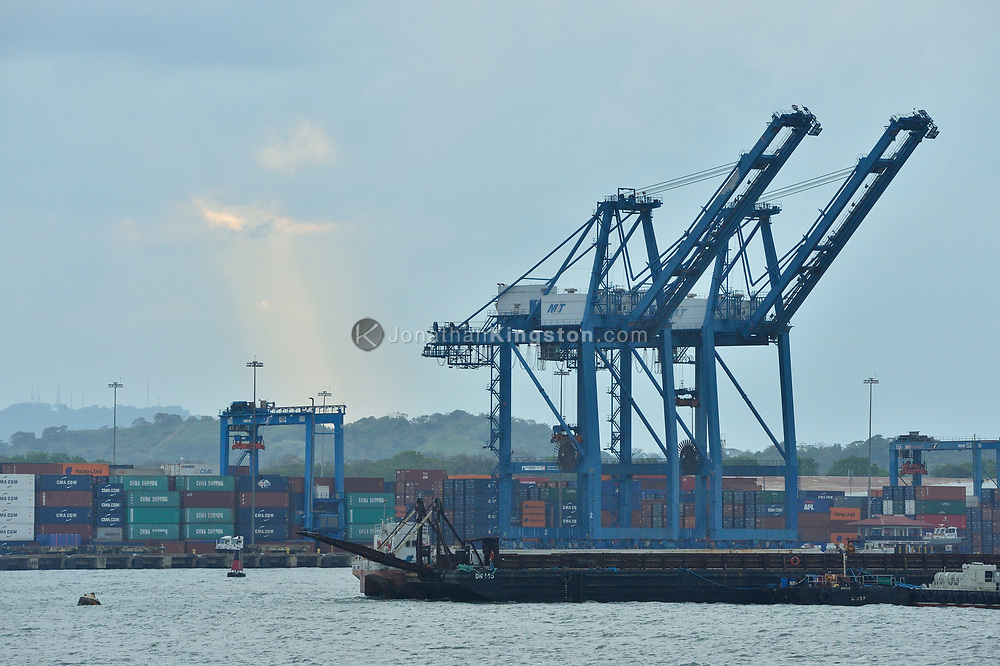 Cargo container cranes at a dock on the Atlantic side of the Panama Canal near the Gatun locks, Panama.