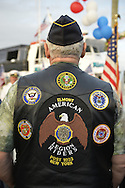 Freeport, New York, USA. September 10, 2014. A member of the Elmont American Legion Riders Post 1033 attends a dockside remembrance ceremony in honor of victims of the terrorist attacks of September 11 2001, at the boat Miss Freeport V, on Freeport's Nautical Mile. Further ceremonies were held on board the vessel, which Capt. Rizzo sailed from the Woodcleft Canal on the South Shore of Long Island, on the eve of the 13th anniversary of the 9/11 attacks.