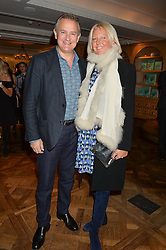 HUGH BONNEVILLE and his wife LULU at a party hosted by Ewan Venters CEO of Fortnum & Mason to celebrate the launch of The Cook Book by Tom Parker Bowles held at Fortnum & Mason, 181 Piccadilly, London on 18th October 2016.