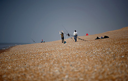 UK ENGLAND DUNGENESS 24MAR12 - Hobby anglers at Dungeness shingle beach on the Kent coast. It is the  largest area of open shingle in Europe, measuring 12 km by 6 km, which has been deposited by the sea and built up over thousands of years.....jre/Photo by Jiri Rezac....© Jiri Rezac 2012