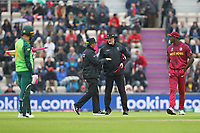 Cricket - 2019 ICC Cricket World Cup - Group Stage: South Africa vs. West Indies<br /> <br /> The Umpires get together to make the decision to halt play as the rain starts to fall at the Hampshire Bowl Southampton England<br /> <br /> COLORSPORT/SHAUN BOGGUST