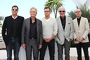 "Screenwriter Richard LaGravenese, actors Michael Douglas, Matt Damon, producer Jerry Weintraub and director Steven Soderbergh attend ""Behind The Candelabra"" photo call  during the 66th Annual Cannes Film Festival at the Palais des Festivals on May 21, 2013 in Cannes, France.."