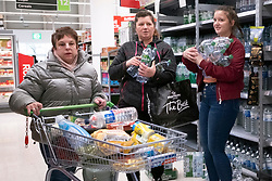© Licensed to London News Pictures. 15/03/2020. London, UK. Shoppers at a London Asda supermarket panic buying items as the Coronavirus disease outbreak spreads across the UK. Household and food items such as pasta, toilet paper and cleaning products have been in short supply. Photo credit: London News Pictures