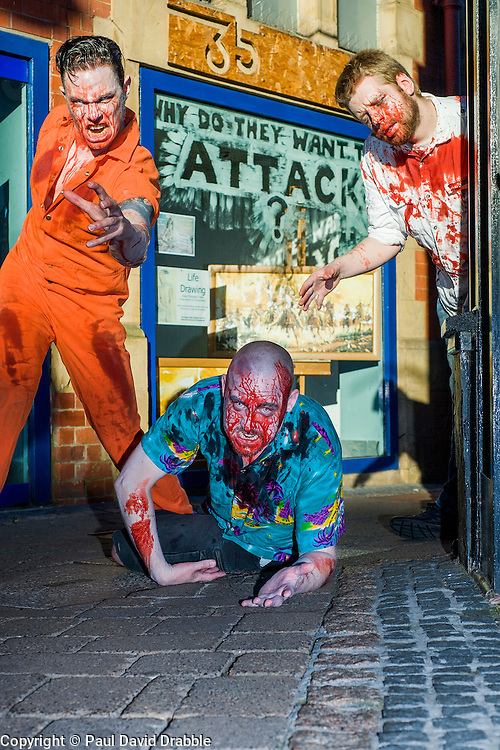Slingshots Top Zombies Alex Noble, Noel Davies-Atack and Paul Byrne on Chapel Walk Sheffield on Tuesday evening ahead of the game 2.8 Hours Later which reaches the city in August <br /> <br /> 30 June 2015<br />  Image © Paul David Drabble <br />  www.pauldaviddrabble.co.uk