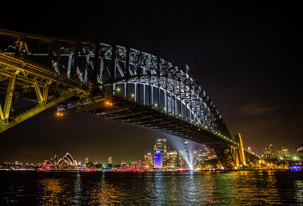 Sydney Harbour Bridge with the Opera House behind it, as viewed from Milson's Point on New Year's Eve.