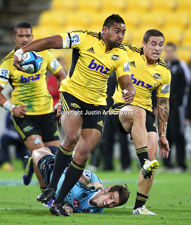 Waratahs' Bernard Foley fails to make the tackle on Hurricans' Julian Savea during the 2013 Super Rugby season - Hurricanes v Waratahs, Westpac Stadium, Wellington, New Zealand on Saturday 6 April 2013. Photo: Justin Arthur / photosport.co.nz