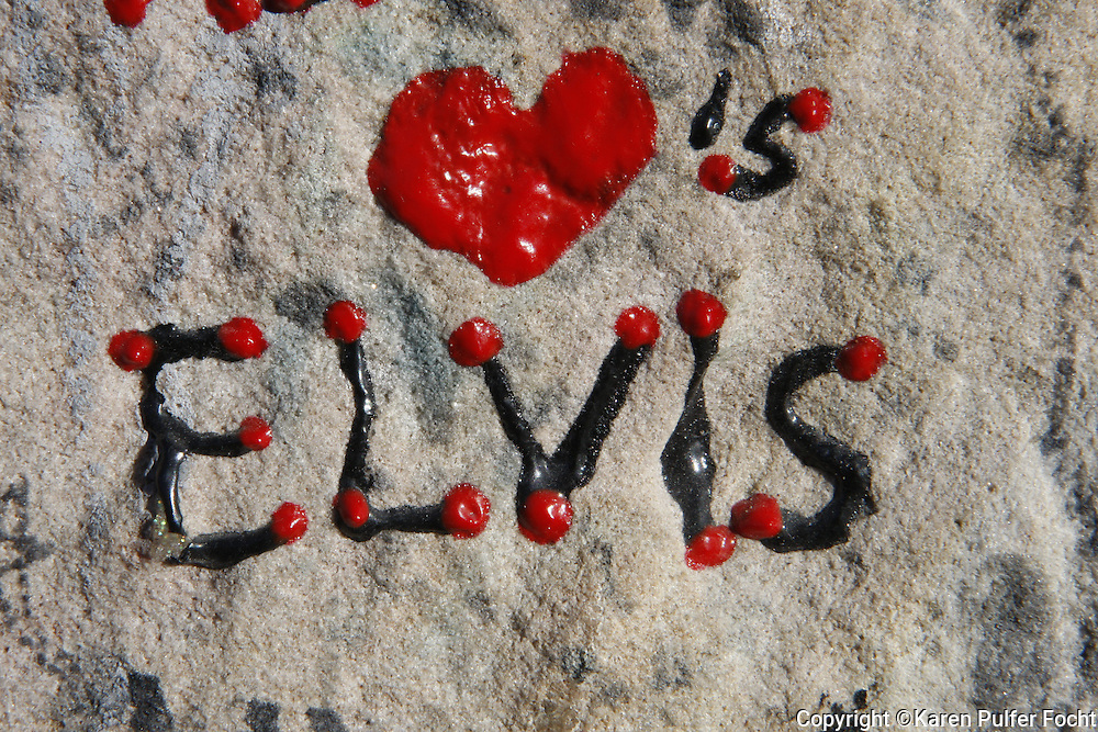 Birthday wishes from around the world, lie around the grave of Elvis Presley at Graceland in Memphis, Tennessee. Elvis would have been 80.  (photo by Karen Pulfer Focht)
