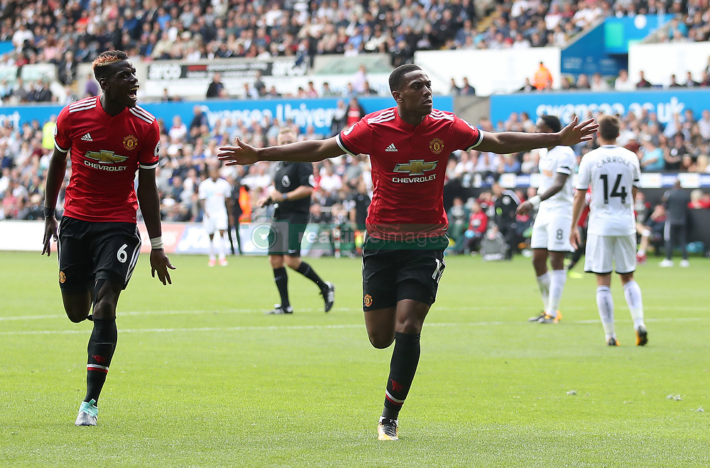 Manchester United's Anthony Martial (right) celebrates scoring his side's fourth goal with team-mate Paul Pogba during the Premier League match at the Liberty Stadium, Swansea.