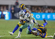 Jan 12, 2019; Los Angeles, CA, USA; Dallas Cowboys running back Ezekiel Elliott (21) attempts to break a tackle from Los Angeles Rams linebacker Mark Barron (26) during an NFL divisional playoff game at the Los Angeles Coliseum. The Rams beat the Cowboys 30-22. (Kim Hukari/Image of Sport)