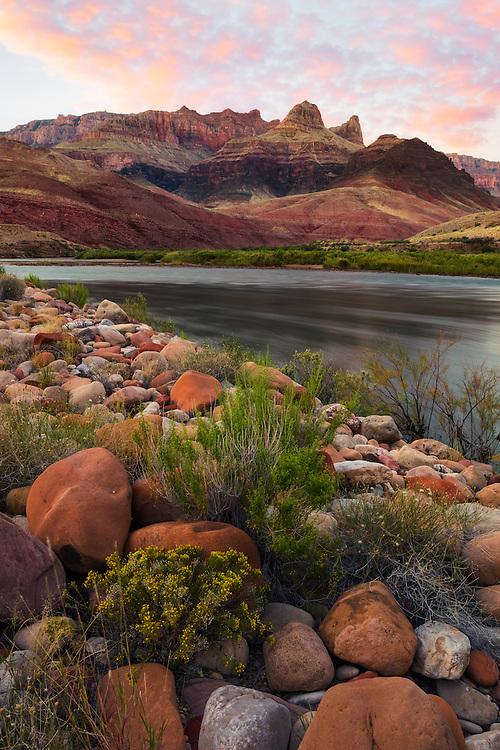 Cardenas Butte and Escalante Butte rise above the Colorado River in the Grand Canyon.
