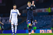 Will Huffer of Leeds United (13) claps the fans after getting a clean sheet on his senior debut, whilst Barry Douglas of Leeds United (3) is all smiles behind him during the EFL Sky Bet Championship match between Leeds United and Bristol City at Elland Road, Leeds, England on 24 November 2018.