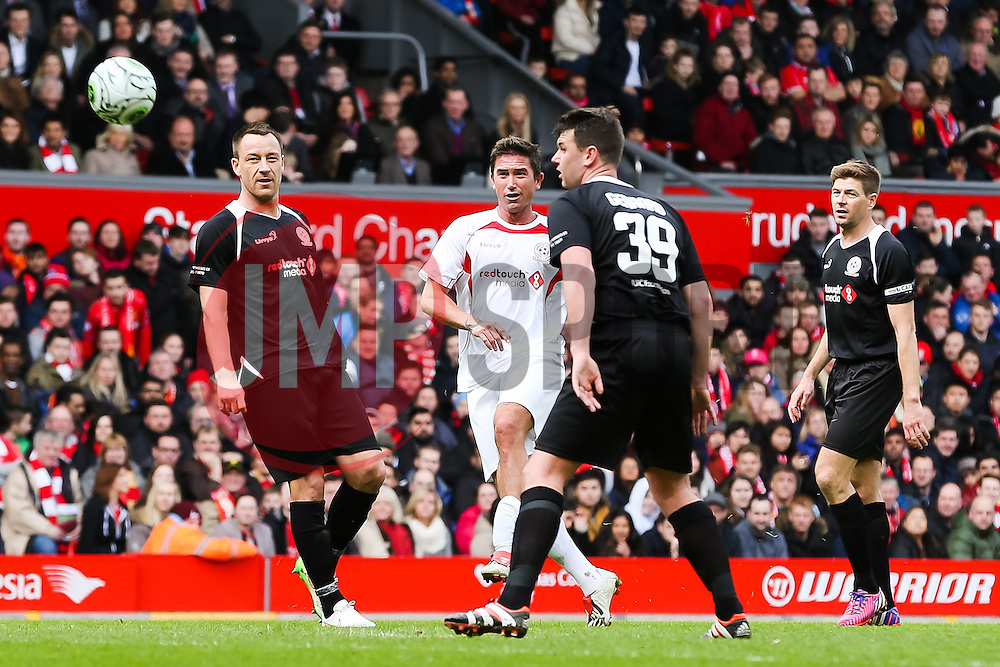 Harry Kewell of the Carragher XI fires a shot towards goal   - Photo mandatory by-line: Matt McNulty/JMP - Mobile: 07966 386802 - 29/03/2015 - SPORT - Football - Liverpool - Anfield Stadium - Gerrard's Squad v Carragher's Squad - Liverpool FC All stars Game