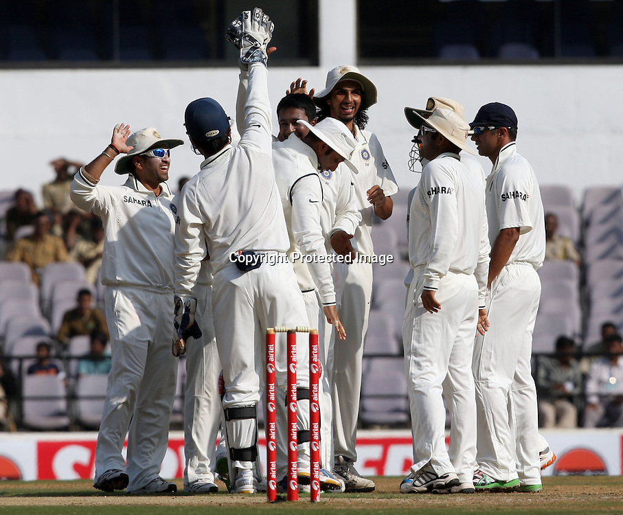 Indian bowler Pragiyan Ojha celebrates with team mates New Zealand batsman Martin Guptill wicket during the 3rd test match India vs New Zealand day-4 Played at Vidarbha Cricket Association Stadium, Jamtha, Nagpur, 23, November 2010 (5-day match)