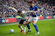 Connor Roberts of Swansea City holds of a challenge by Marlon Pack of Cardiff City during the EFL Sky Bet Championship match between Cardiff City and Swansea City at the Cardiff City Stadium, Cardiff, Wales on 12 January 2020.