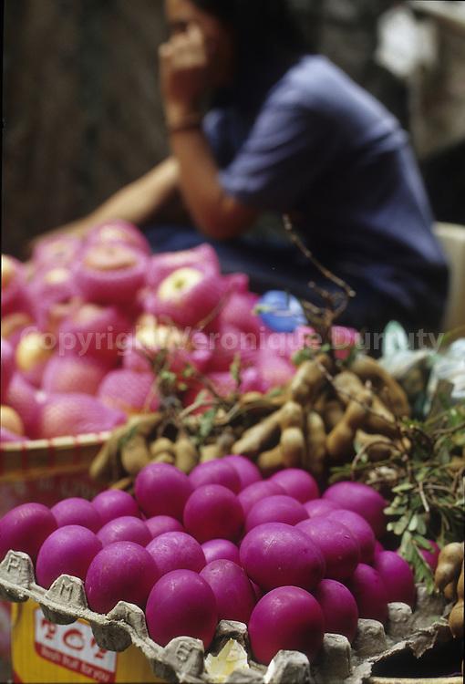 PINK EGGS. MARKET IN MAINIT VILLAGE, CORDILLERA, NORTH LUZON, THE PHILIPPINES