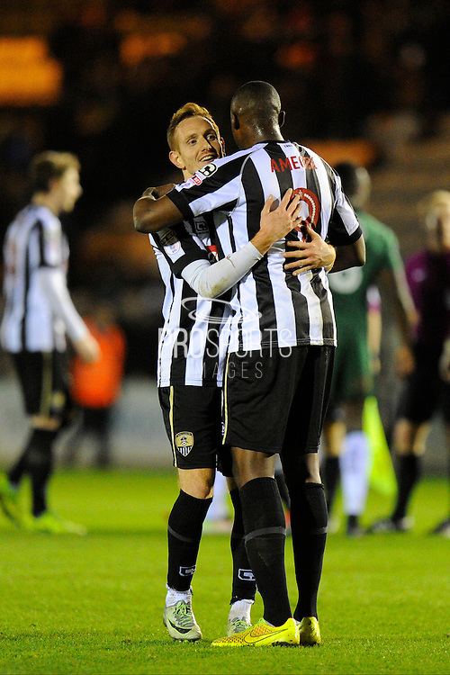 Robert Milsom (12) of Notts County and Shola Ameobi (9) of Notts County hug as they celebrate the 1-0 win over Plymouth at full time during the EFL Sky Bet League 2 match between Plymouth Argyle and Notts County at Home Park, Plymouth, England on 28 February 2017. Photo by Graham Hunt.