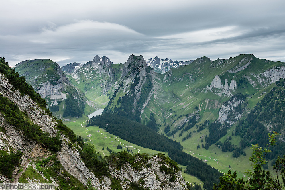 Hiking trail on ridge above  the lake of Fälensee in the Alpstein range, Appenzell Alps, Switzerland, Europe. Fälensee (1446 m) is in a narrow valley between Hundsteingrat and Roslen-Saxer First. Appenzell Innerrhoden is Switzerland's most traditional and smallest-population canton (second smallest by area).