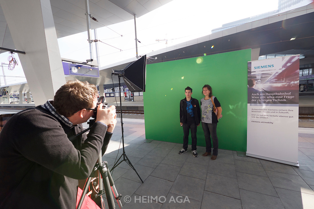 Vienna's new Hauptbahnhof (Main Railway Station) opening days. Souvenir photos for visitors, digital composites with cities reachable by rail from here.
