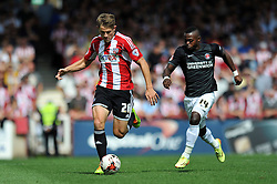 Brentford's James Tarkowski in possession - Photo mandatory by-line: Patrick Khachfe/JMP - Mobile: 07966 386802 09/08/2014 - SPORT - FOOTBALL - Brentford - Griffin Park - Brentford v Charlton Athletic - Sky Bet Championship - First game of the season
