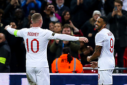 Callum Wilson of England celebrates with teammate Wayne Rooney of England after scoring a goal 3-0 - Mandatory by-line: Robbie Stephenson/JMP - 15/11/2018 - FOOTBALL - Wembley Stadium - London, England - England v United States of America - International Friendly