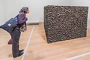 Socle du Monde 1992-3 - Mona Hatoum a new Tate Modern exhibition. It presents around 100 works from the 1980s to the present day, including early performances and video, sculpture, installation, photography and works on paper. Mona Hatoum runs from 4 May to 21 August 2016.<br /> <br /> Highlights include:  Large-scale installations that fill entire rooms, including Impenetrable 2009, a suspended square formed of hundreds of delicate rods of barbed wire which hover above the floor, and Light Sentence 1992, in which walls of wire mesh lockers and a single lightbulb cast constantly moving shadows; Hot Spot 2013, a giant globe that uses red neon to outline the contours of the continents; a kinetic sculpture in which a rotating motor-driven arm draws circular lines across a large sandpit; and Homebound 2000, an installation of kitchen utensils and furniture which buzzes with electricity