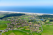 Nederland, Friesland, Ameland, 05-07-2018; hoofdplaats van het eiland, het dorp Nes. Vakantieparken in de achtergrond.<br /> Main village of the island, Nes. Holiday park in the background.<br /> luchtfoto (toeslag op standard tarieven);<br /> aerial photo (additional fee required);<br /> copyright foto/photo Siebe Swart