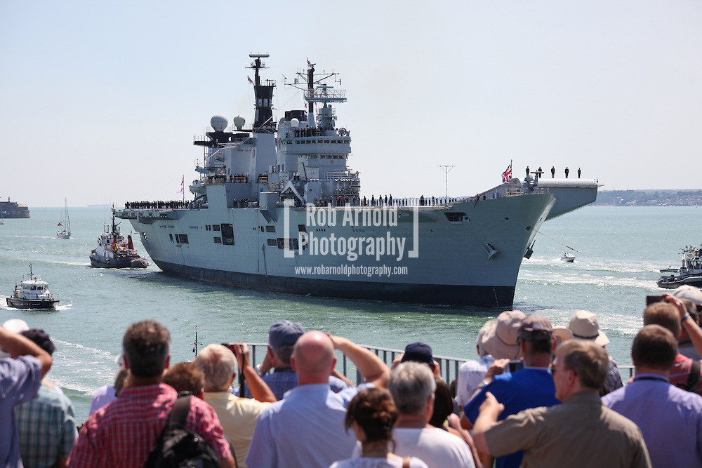 © Rob Arnold.  22/07/2014. Hampshire, UK. The Royal Navy's helicopter carrier, HMS Illustrious, sails into her homeport of Portsmouth for the final time before a decommissioning ceremony later this year. The former aircraft carrier, nicknamed 'Lusty', is the last of the Invincible Class carriers, and will be retired after 32 years of active service and replaced by the recently refitted HMS Ocean. Photo credit : Rob Arnold